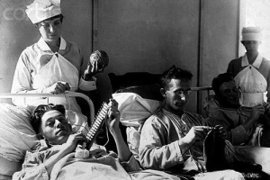ca. 1918-1919, Walter Reed Hospital, Washington, DC, USA — Bed-ridden wounded knit to help pass the time. Walter Reed Hospital, Washington, DC, ca. 1918-1919. — Image by © CORBIS